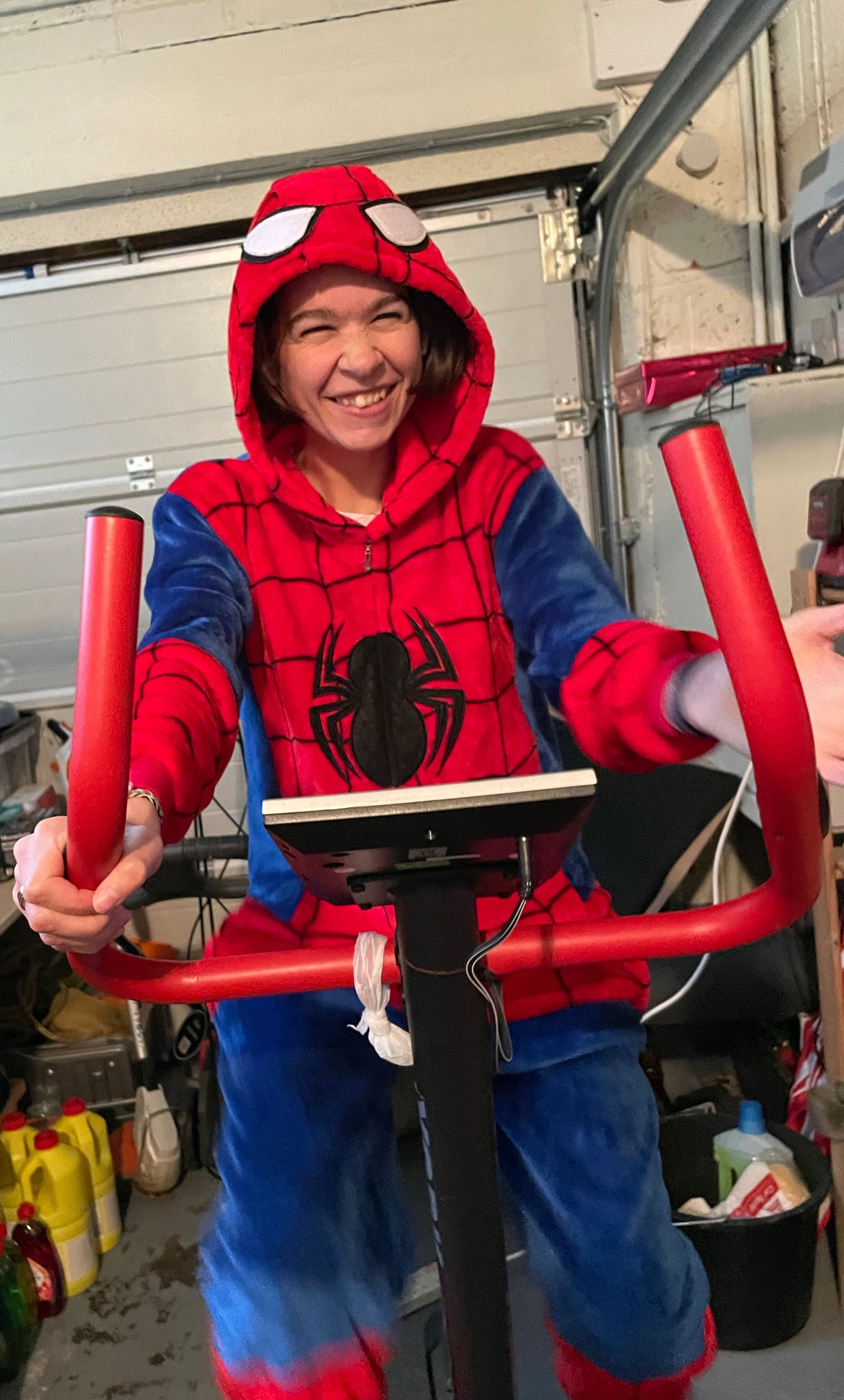 Me sat. On the exercise bike in my Spider-Man onesie laughing.